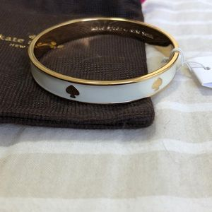 NWT Kate Spade white and gold spade bangle